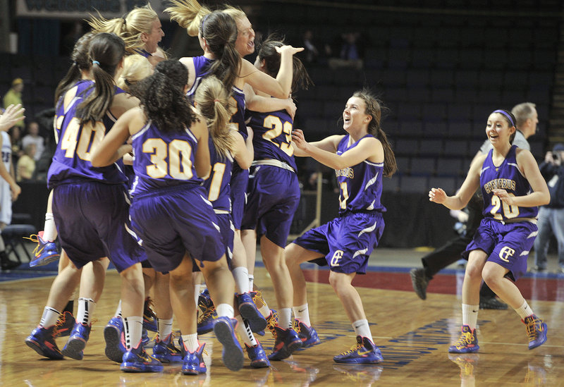 The Cheverus High girls' basketball players rush the court Friday night after holding on to a 33-31 victory against Deering in the Western Class A semifinals at the Cumberland County Civic Center. The Stags will meet McAuley for the title Saturday night.