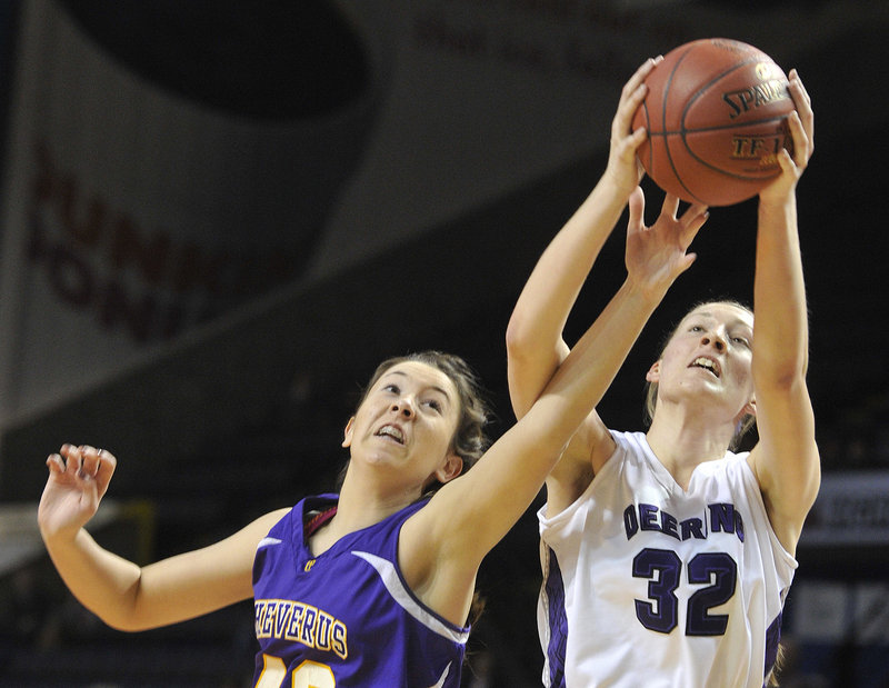 Jess Willerson, left, of Cheverus tries to knock a rebound away from Marissa MacMillan of Deering during their Western Class A girls' basketball semifinal Friday night at the Cumberland County Civic Center. Cheverus won 33-31 and will meet McAuley for the title.