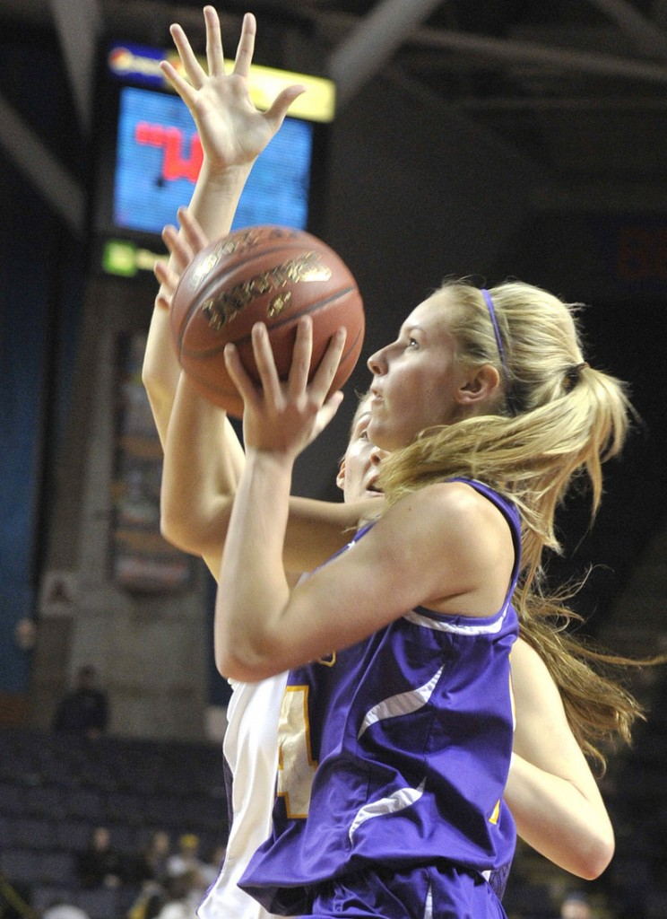Brooke Flaherty of Cheverus heads to the basket while guarded by Marissa MacMillan of Deering.
