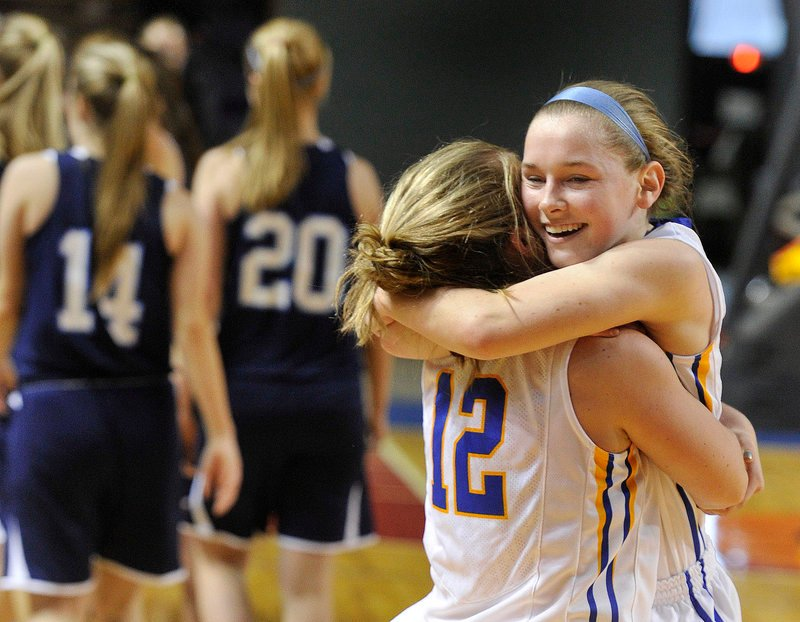 Lake Region's Sarah Hancock, left, gets a hug from her sister Sierra after the Lakers' win over York in the Western Class B regional final Saturday.