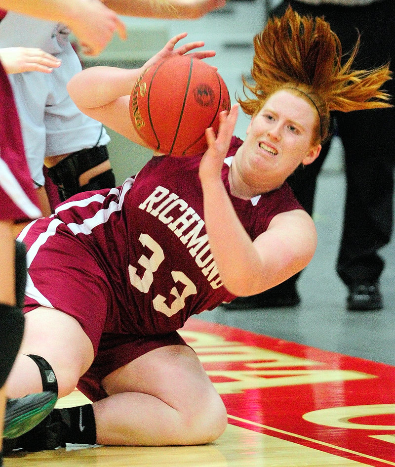Alyssa Peterson of Richmond goes to the ground to keep the ball in play during the Western Class D win over Rangeley.
