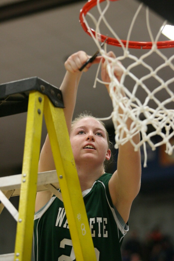 Waynflete's Catherine Veroneau cuts the net down after the Flyers won their Western Class C regional final at the Augusta Civic Center.