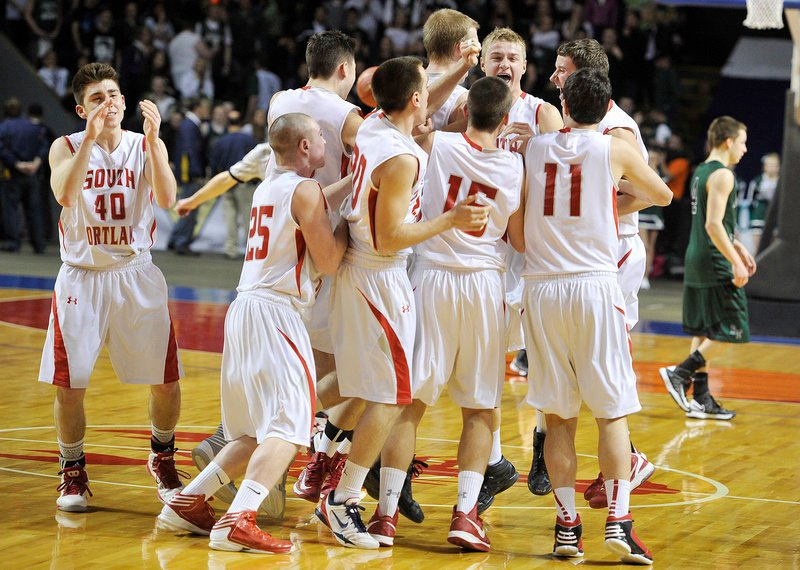 South Portland celebrates its Western Class A boys regional championship, after beating Bonny Eagle 56-52 at the Cumberland County Civic Center on Saturday. It's the first time since 1993 the Red Riots have won a regional title.