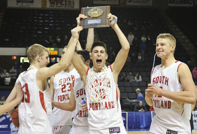 What more could they want? A Gold Ball? That chance is next, but for now, Calvin Carr, center, Tanner Hyland, left, and Ben Burkey of South Portland love the spoils.