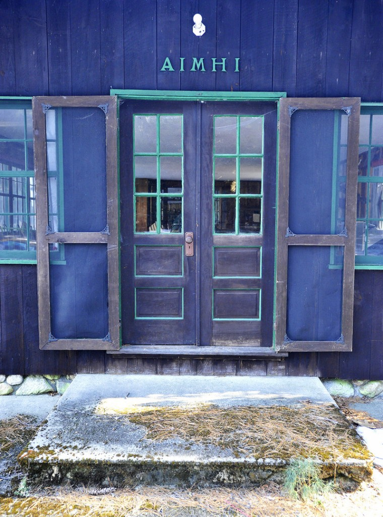 A colorful door leads into the main lodge's playroom at Aimhi Lodge, once a popular family lodge on Little Sebago Lake.