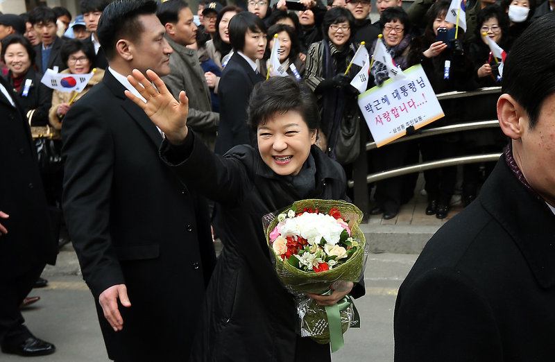 South Korea's new president, Park Geun-hye, waves to supporters on the way to her inauguration ceremony at the National Assembly in Seoul, South Korea, Monday.