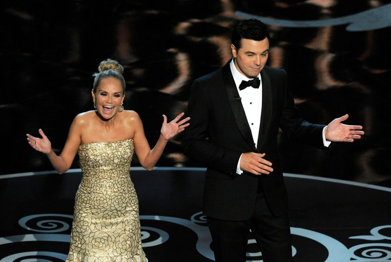 "Host Seth MacFarlane and actress Kristin Chenoweth perform a song dedicated to the ""losers"" during the finale of the Oscars on Sunday in Los Angeles."