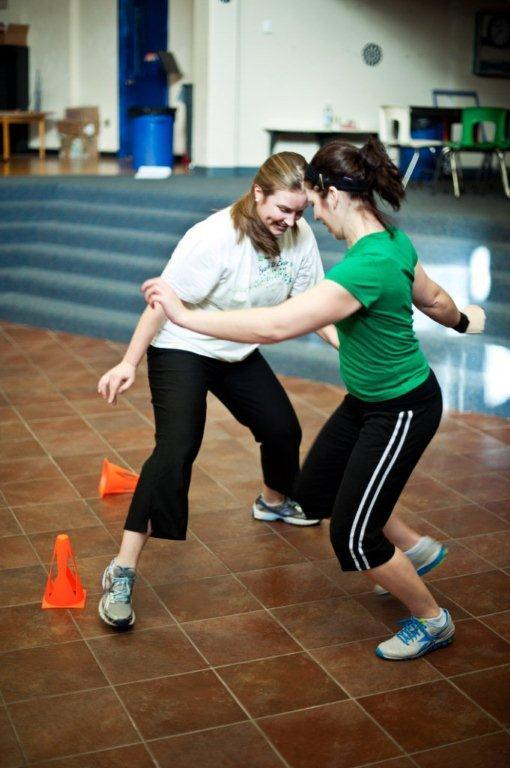 "Katie Bell and Tina Burnell play ""cone tag"" during a Punk Rope class at Riverton Elementary School. The class begins with stretching and moves on to a series of mini-sessions that include jumping rope and schoolyard games. It's all set to ""fast and fun"" music, says instructor Allison Kennie."