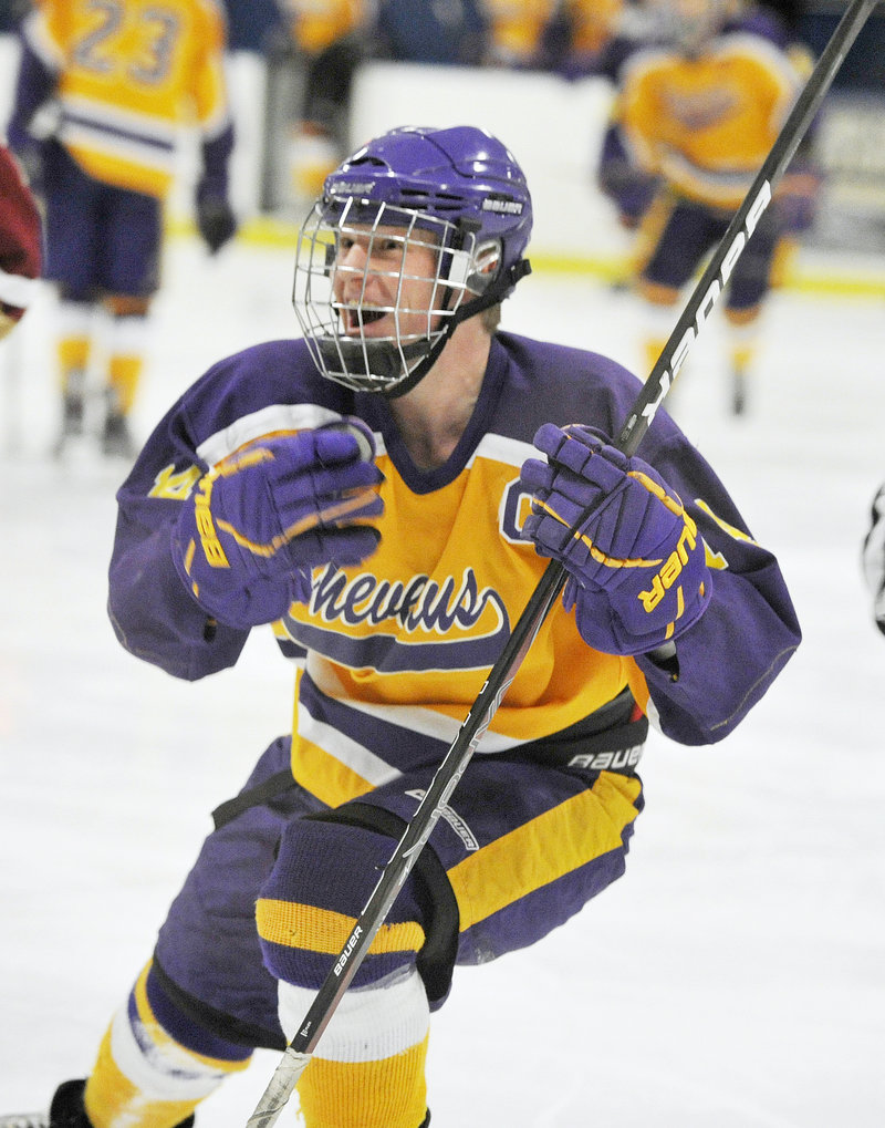 Liam Fitzpatrick, who would score the second-overtime winner, celebrates a second-period goal for Cheverus.