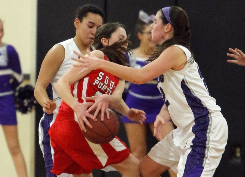 South Portland's Maddie Hasson gets caught between Deering's Keneisha DiRamio, left, and Chelsea Saucier Monday night in Portland.