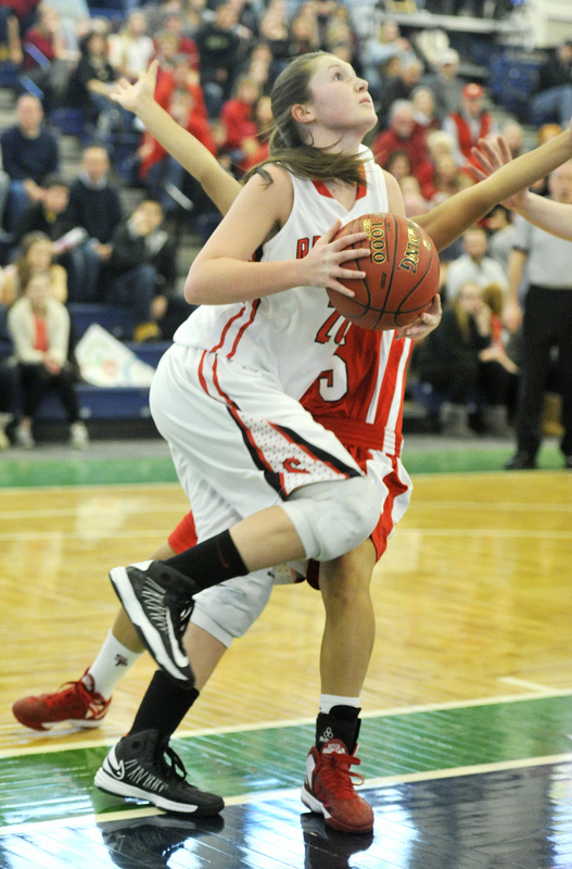 Ashley Briggs of Scarborough heads to the basket during the 45-32 victory over South Portland.