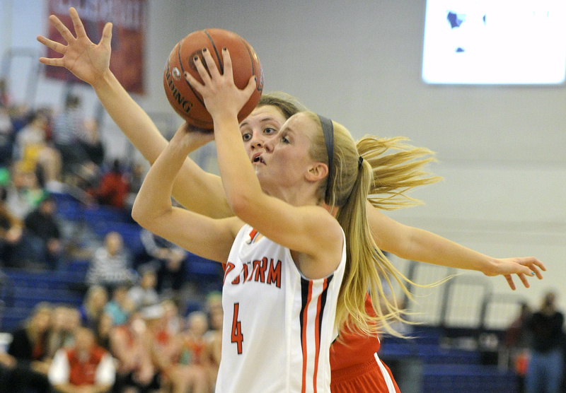 Maria Philbrick of Scarborough looks to get off a shot while defended by Brianne Maloney of South Portland. Scarborough won 45-32 to set up a game with McAuley.