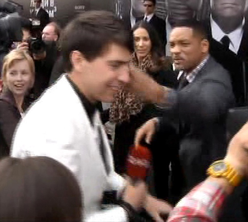 "U.S. actor Will Smith, right, slaps reporter Vitalii Sediuk before the premiere of ""Men in Black III"" last May in Moscow."