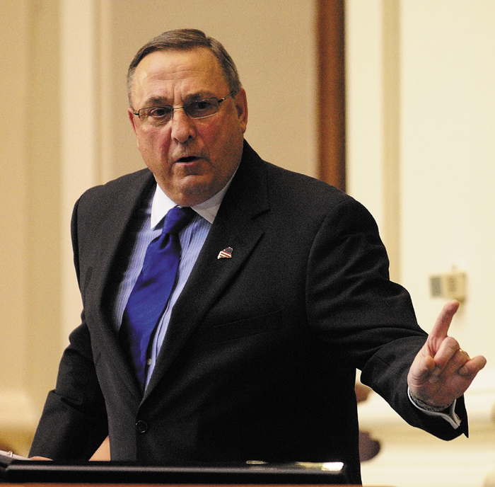 Gov. Paul LePage gestures while giving the State of the State address on Tuesday, Feb. 5, 2013 at the State House in Augusta.