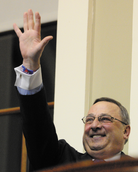 Staff photo by Joe Phelan Gov. Paul LePage waves as he mounts the rostrum to give the State of the State address on Tuesday February 5, 2013 in the State House in Augusta.