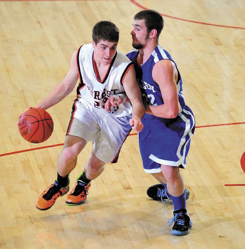 Forest Hills' Evan Worster, left, drives past Valley's Josh West during the Western Maine Class D championship game Saturday at the Augusta Civic Center.