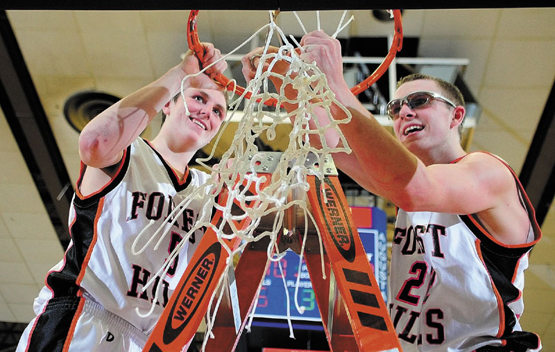 Forest Hills players Ryan Petrin, left, and Derick Ouellette cut down the net after winning the Western Class D boys' championship game Saturday at the Augusta Civic Center. The Tigers beat Valley, 40-33.
