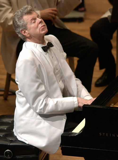 Pianist Van Cliburn performs with the Boston Symphony Orchestra at Tanglewood in Lenox, Mass., on July 12, 2003.