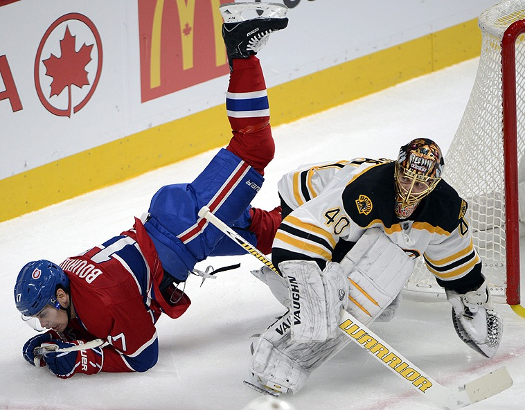 Rene Bourque of Montreal flips over Bruins goalie Tuukka Rask in Wednesday's game at Montreal. The Bruins moved into first place with a 2-1 win. Canada Quebec Montreal hockey;NHL;athlete;athletes;athletic;at