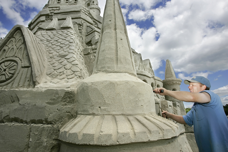 In this file photo from 2007, Ed Jarrett tries set a new Guinness World Record for the tallest sand castle at Point Sebago Resort in Casco.