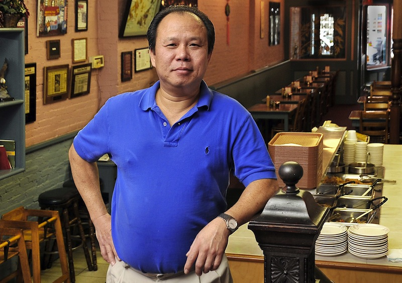 In this October 2010 file photo, Monday, a portrait of Yan Lam, owner of the Oriental Table at 106 Exchange St. in Portland. The longtime local eatery is closing its doors at the end of the month, and its future is uncertain.