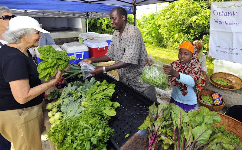 In this 2011 file photo, Nancy Gage of South Portland, left, buys Swiss Chard from Mohamed Abukar, who sells organic vegetables from Fresh Start Farms in Lisbon at the South Portland farmers market. The market, which was established in 2011, is without a home for the upcoming summer season, according to its manager.