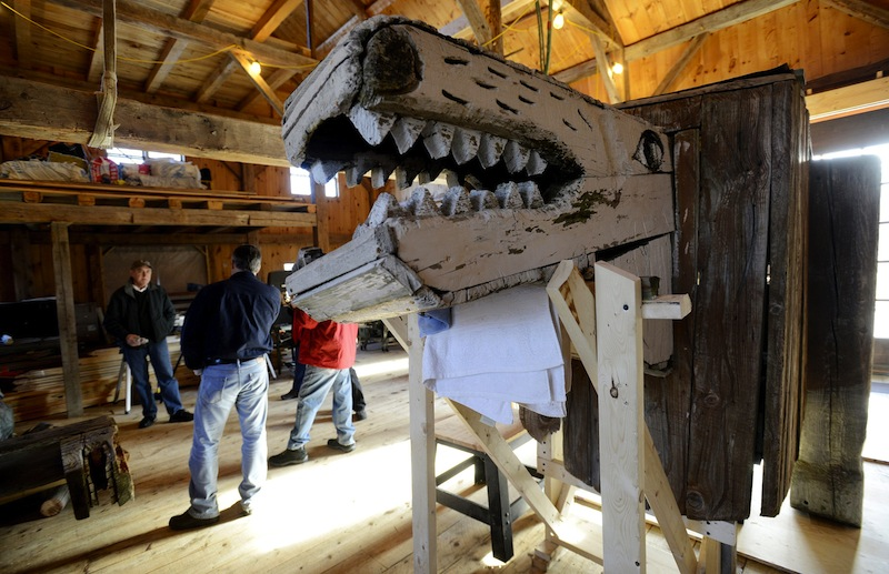 "In this November 2012 file photo, a lion by Bernard Langlais is being restored at Preservation Timber Framing. The work of the late Maine artist Bernard ""Blackie"" Langlais will be distributed for free and the place where he made it will be preserved, in an arrangement announced Monday by the Colby College Museum of Art."