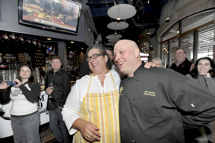 Lisa Kostopolos of The Good Table Restaurant and Jeff Landry of The Farmer's Table react after learning they would share first place at The Incredible Breakfast Cook-Off held at Sea Dog Brewing Co. in South Portland on Friday.