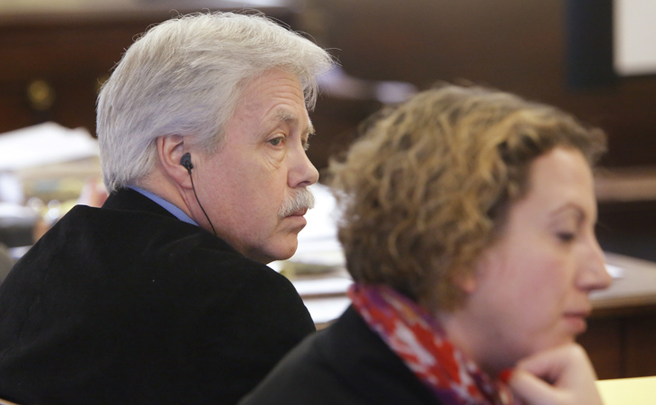 Mark Strong Sr. listens as his attorney, Daniel Lilley, asks Justice Nancy Mills to dismiss charges against him in York County Superior Court in Alfred on Tuesday.
