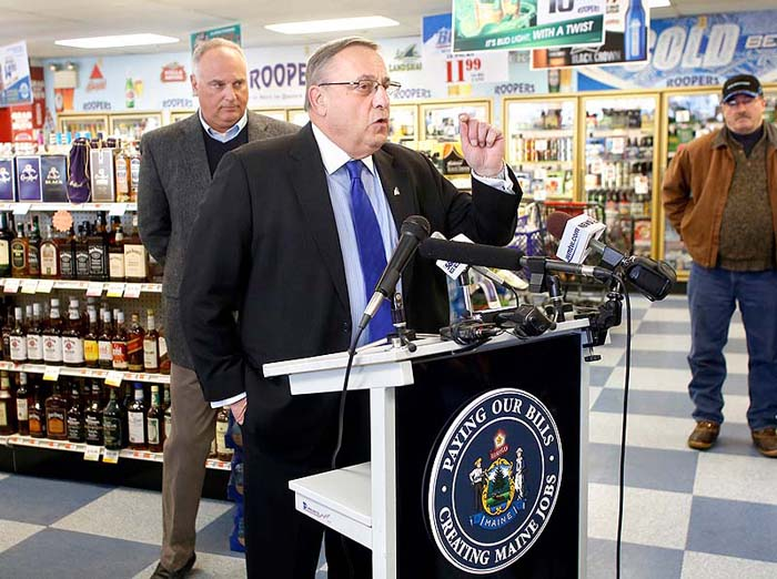 Gov. Paul LePage speaks to the media Friday during his visit to Roopers Beverage in Auburn to discuss his plan to pay back hospital debt by leveraging future liquor sale revenue.