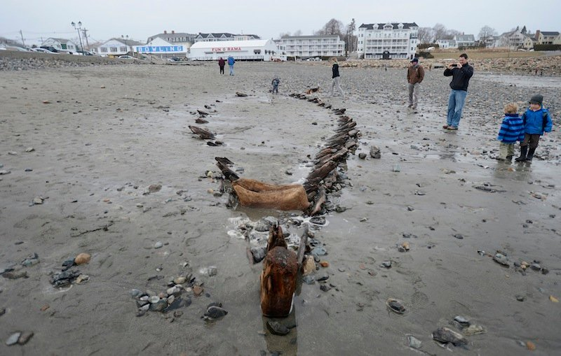 Beachgoers Look Over A Ship S Hull Monday That Was Uncovered At Short Sands Beach In York