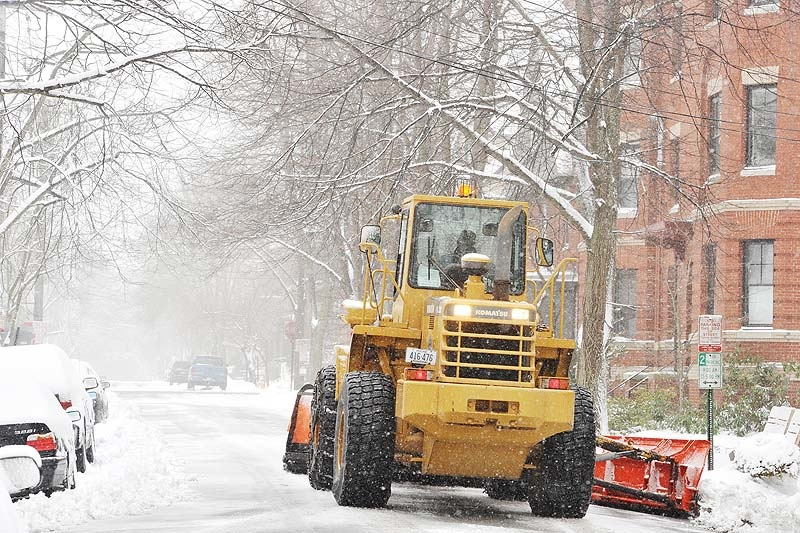 A Portland plow driver makes his way up Neal Street in the city's West End as a late-season snowstorm begins to pummel Maine on Tuesday, March 19, 2013