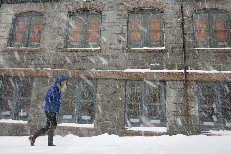 Adam King of Portland walks past the St. Lawrence Arts and Community Center on Congress Street on Tuesday, March 19, 2013 during a late season snowstorm.