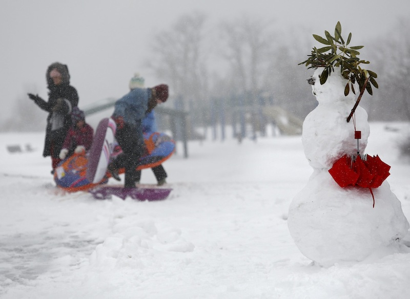 Sledders gets set to slide down the hill on the East End in Portland on Tuesday, March 19, 2013, during a late season snowstorm in Maine.
