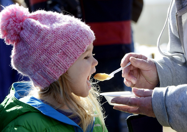 Persephone Karecki 3, of Newfield takes a bite of a pancake soaked in maple syrup while visiting Hilltop Boilers in Newfield on Maine Maple Sunday.