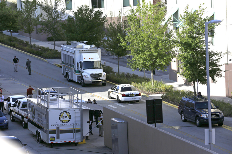 "Investigators from various law enforcement agencies converge on the University of Central Florida in Orlando on Monday. Explosive devices were found after the apparent suicide of a former student who authorities said had planned an attack and ""laid out a timeline."""