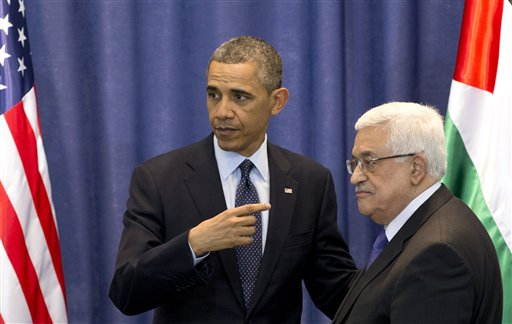 U.S. President Barack Obama, left, and Palestinian President Mahmoud Abbas leave after a joint news conference at the Muqata Presidential Compound, in the West Bank town of Ramallah, on Thursday.