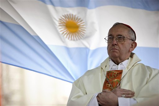 In this Aug. 7, 2009 file photo, Argentina's Cardinal Jorge Bergoglio gives a Mass outside the San Cayetano church where an Argentine flag hangs behind in Buenos Aires, Argentina. On Wednesday, March 13, 2013, Bergoglio was elected pope, the first ever from the Americas and the first from outside Europe in more than a millennium. He chose the name Pope Francis. (AP Photo/Natacha Pisarenko)