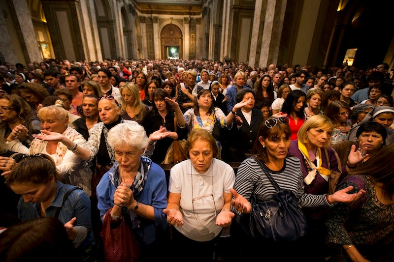 Worshipers pack the Metropolitan Cathedral during the evening Mass in Buenos Aires, Argentina, Wednesday, March 13, 2013. Latin Americans reacted with joy on Wednesday at news that the Argentine Cardinal Jorge Mario Bergoglio, was elected pope. Bergoglio, who chose the name Pope Francis, is the first pope ever from the Americas. (AP Photo/Victor R. Caivano)