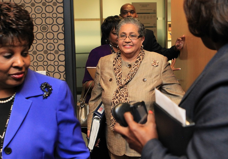 In this June 13, 2011 file photo, outgoing schools superintendent, Dr. Beverly Hall, center, arrives for her last Atlanta school board meeting at the Atlanta Public Schools headquarters in Atlanta. Hall and nearly three dozen other administrators, teachers, principals and other educators were indicted Friday, March 29, 2013, in one of the nation's largest cheating scandals. (AP Photo/Atlanta Journal-Constitution, Curtis Compton) Beverly Hall