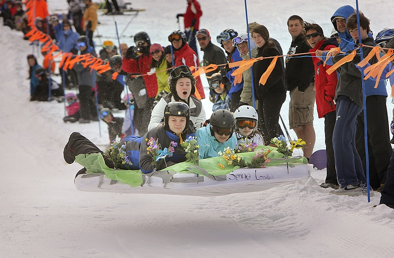 A team dubbed Spring Loaded, Eddie Grace, Noelle Veillette, Catherine Menousek and Amy McGurk, left to right, gets some air while competing in the 6th annual Mattress Race at Shawnee Peak in Bridgton on Saturday. The team came in fourth in the race.