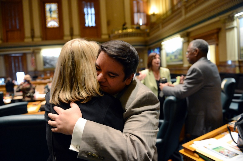 Colorado Rep. Dominick Moreno, D-Commerce City, gets a hug from Rep. Brittany Petteren, D-Lakewood, following Tuesday's vote on a bill giving gay couples rights similar to marriage.