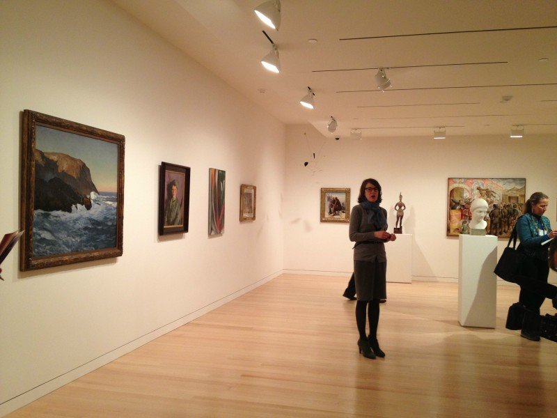 Colby College Museum of Art director Sharon Corwin describes the layout of a gallery on Monday, March 25, 2013. In foreground is a painting by Rockwell Kent.