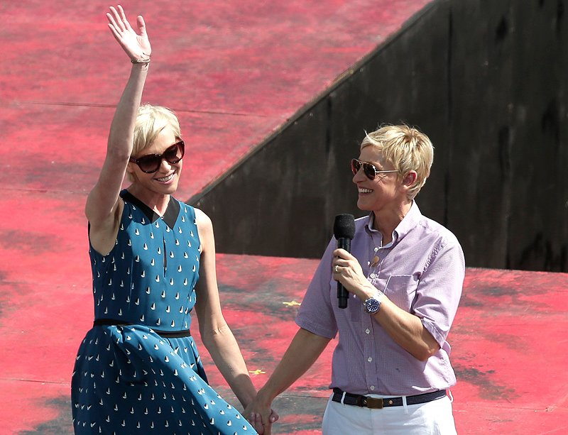 Talk show host Ellen DeGeneres, right, introduces her wife, Portia de Rossi, Saturday in Sydney, Australia.