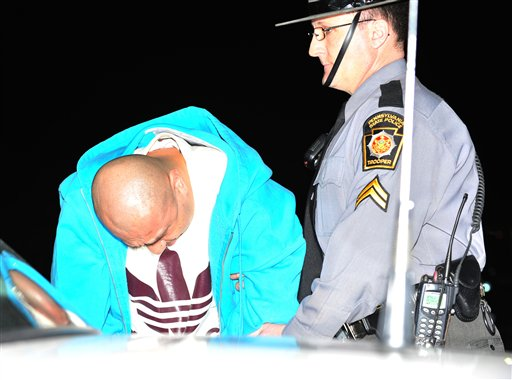 Pennsylvania State Police transport Julio Acevedo, 44, from the State Police Barracks in Bethlehem, Pa, Wednesday night to the Lehigh County Prison.