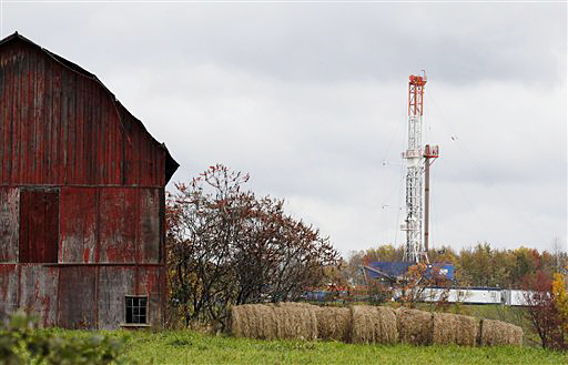 A drilling rig is set up near a barn in Springville, Pa., to tap gas from the giant Marcellus Shale gas field. The overview project will cover Pennsylvania, West Virginia and Ohio – where a frenzy of drilling is under way – as well as New York and other states in the East that have put a hold on new drilling.