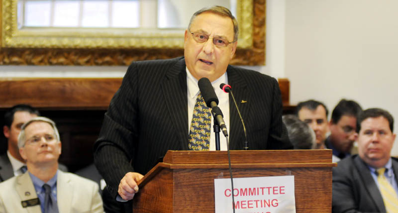 Gov. Paul LePage addresses the Legislature's Veterans and Legal Affairs Committee Monday at the State House in Augusta. LePage urged lawmakers to pass his proposal to put the state liquor contract out to bid.