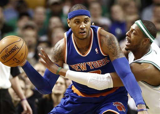Carmelo Anthony, who scored 29 points Tuesday night for the New York Knicks, keeps the ball away from Paul Pierce of the Boston Celtics during New York's 100-85 victory at Boston.