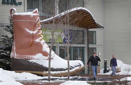 Shoppers walk past the iconic L.L. Bean boot outside the L.L. Bean retail store on Friday in Freeport.