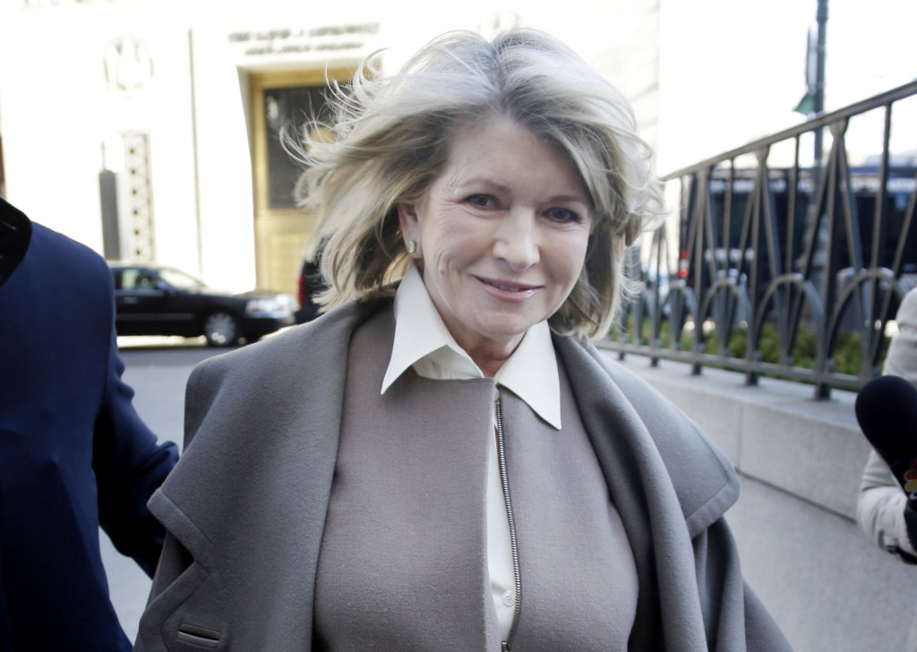Martha Stewart arrives to court in New York on Tuesday. Macy's Inc. is suing the media and merchandising company Stewart founded for breaching an exclusive contract when she signed a deal with J.C. Penney in December 2011 to open shops at most of its stores this spring.